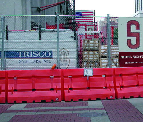 Ally Rental Plastic Jersey Barriers Used with Chain Link Fence